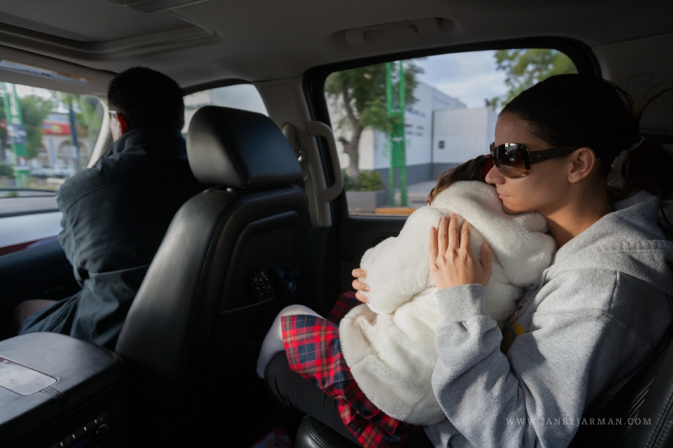 Joses Wife Clutches Her Daughter On The Way To School Accompanied By Their Personal Bodyguards Each Family Member Has A Security Agent Accompanying Them